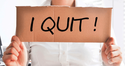 employee holding a sign saying I Quit