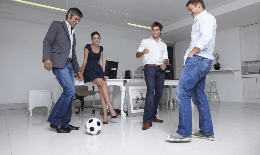 startup employees playing soccer in the office