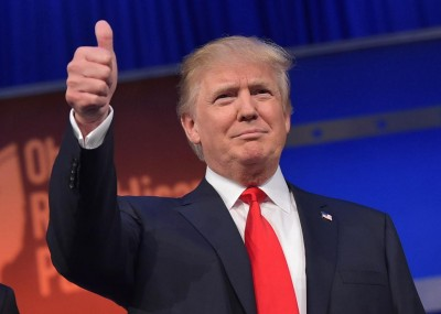real estate tycoon donald trump flashes the thumbs up