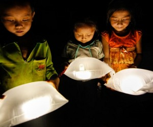 children using LuminAID solar power lights