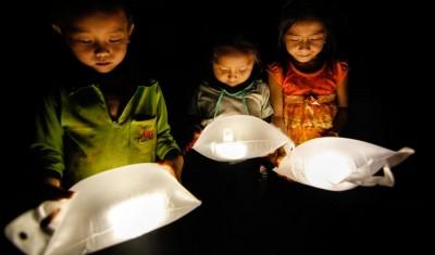 children using LuminAID solar power lights