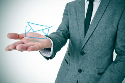 salesman holding email icon