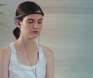 woman meditates while wearing the Muse headband
