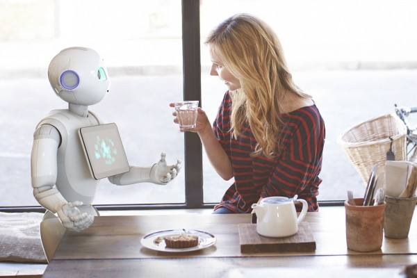 robot and human having a conversation over coffee