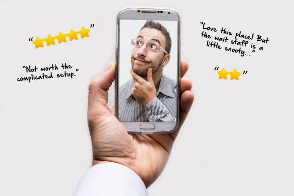 online reviews and man on iPhone thinking about them