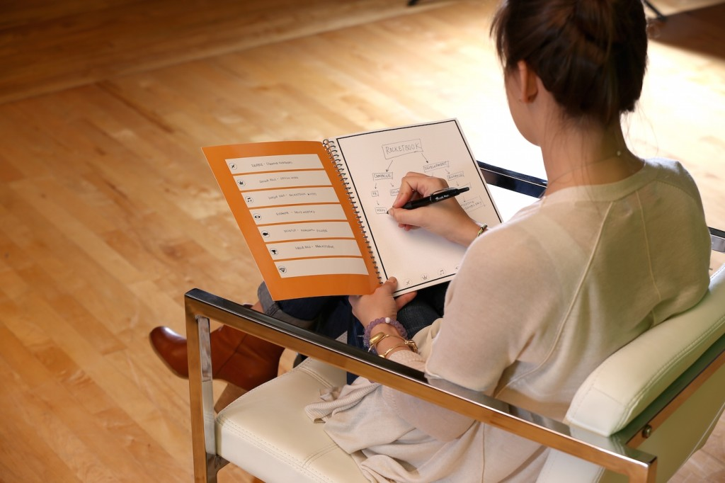 Woman using RocketBook microwavable smart notebook