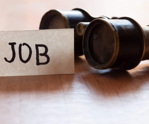 Binoculars and job sign symbolizing job search tools