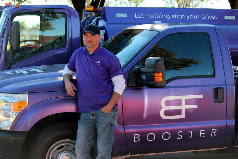 Booster gas truck and employee