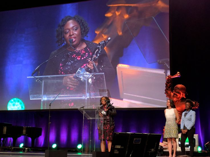 African-American female tech founder receiving Crunchie award