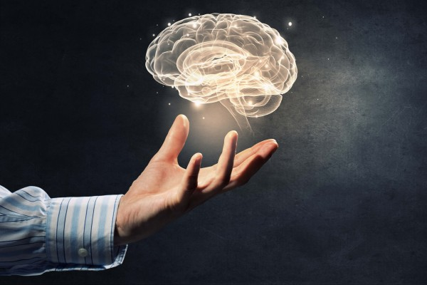 hand holding brain representing genetic testing for mental health