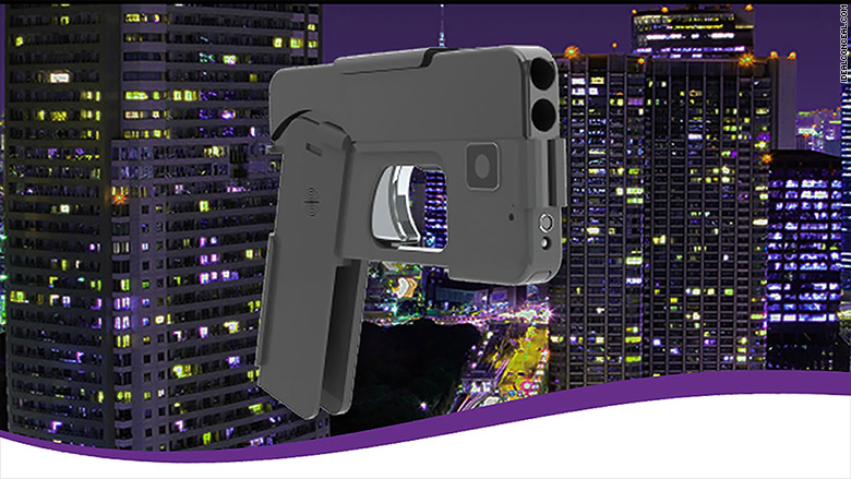 hand gun concealed as smart phone