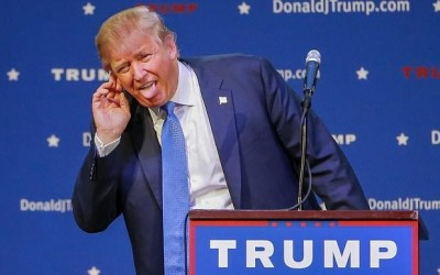 Donald Trump sticking tongue out on stage