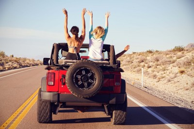 girls in Jeep on road trip