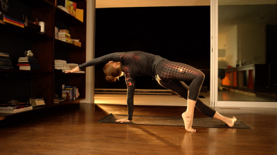 smart exercise clothes worn by woman doing yoga