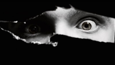 man's eyes providing surveillance and no privacy
