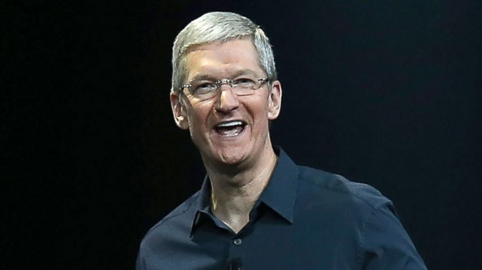 Apple's Tim Cook laughing, possibly at the FBI unlocking an iPhone