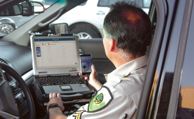 police analyzing phone for texting while driving using Cellbrite technology