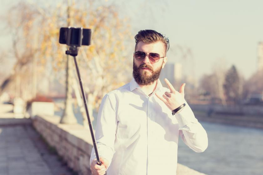 bearded hipster with his selfie stick