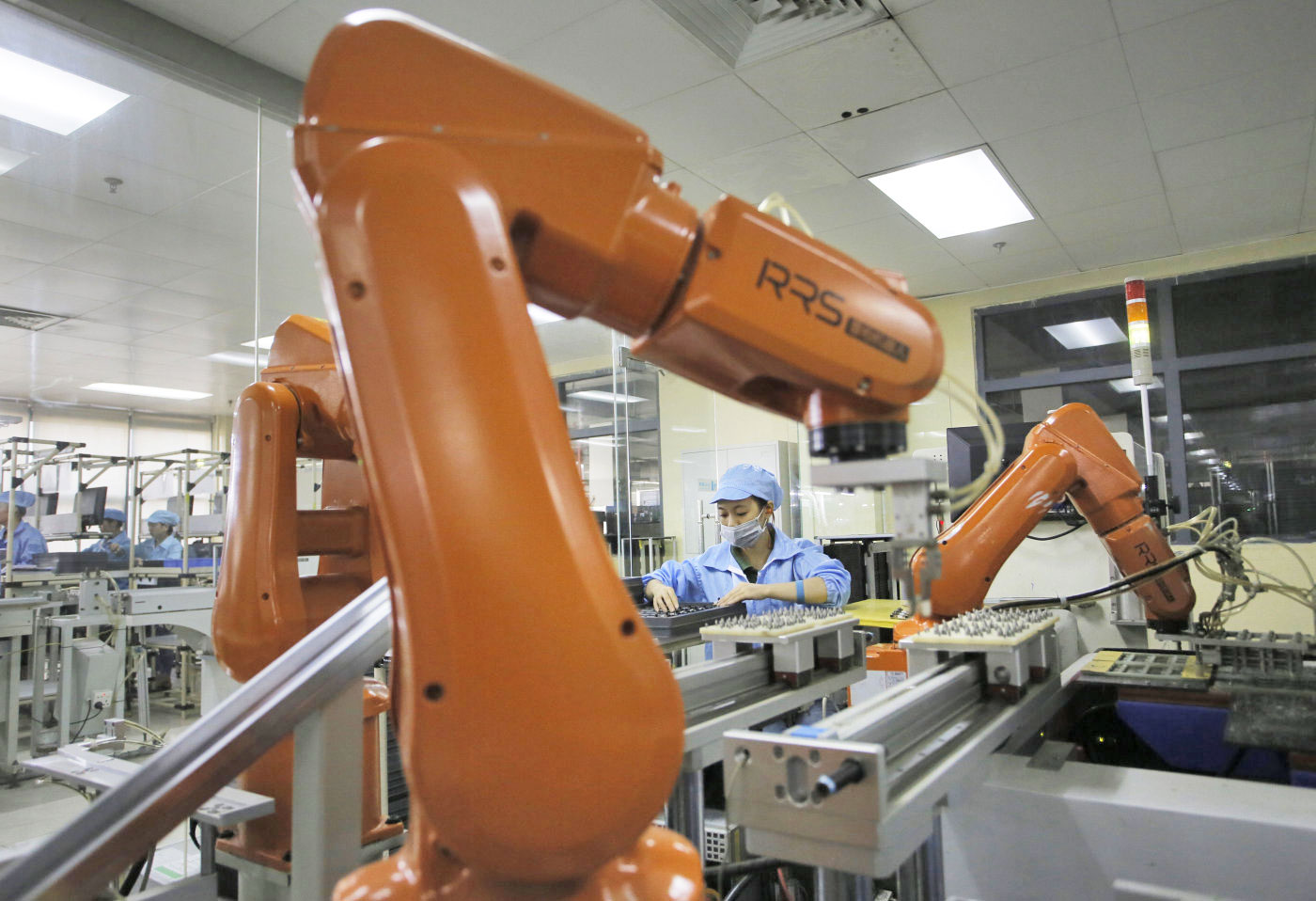 robots in Foxconn plant making Apple iPhones and Samsung smartphones