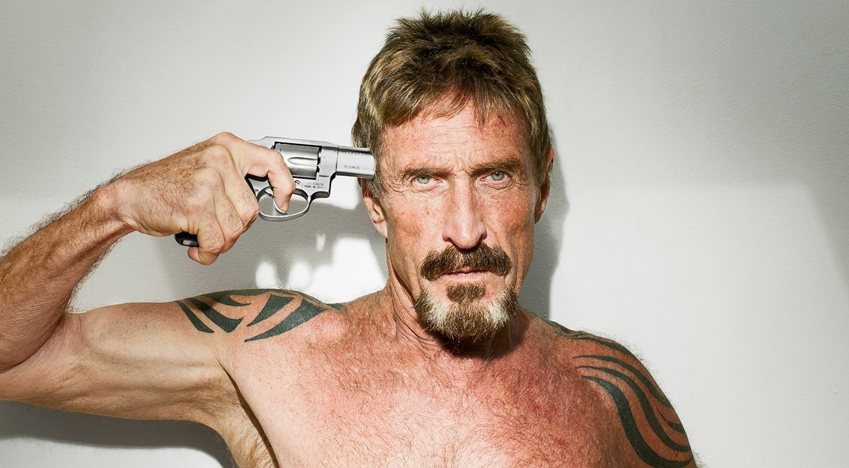 crazy computer programmer John McAfee with gun to his head