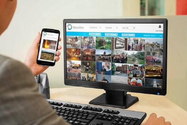 journalist reviewing photography on Newslinn image sharing platform