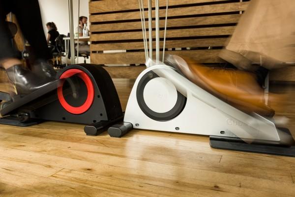 people using the Cubii under-desk portable elliptical