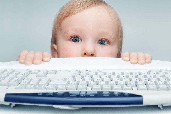 baby hacker in front of computer keyboard