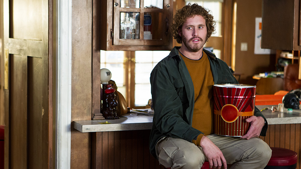 Erlich Bachman of HBO's Silicon Valley eats popcorn