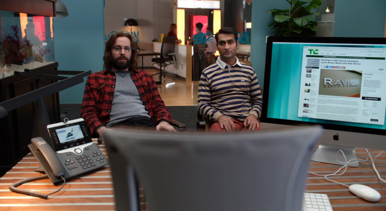 software developers on HBO's Silicon Valley stare at an empty chair