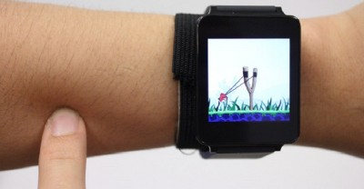 person wearing smartwatch uses SkinTrack to make their whole arm a touchpad