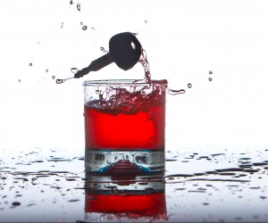 key falling in alcohol to represent wearables that prevent drinking and driving