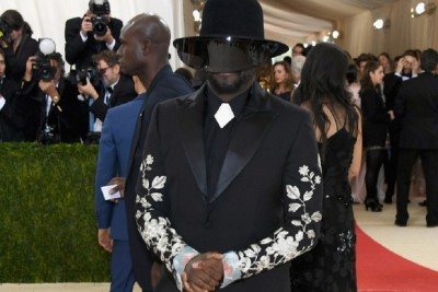 Will.i.am at The Met Gala wearing a tux with artificial intelligence