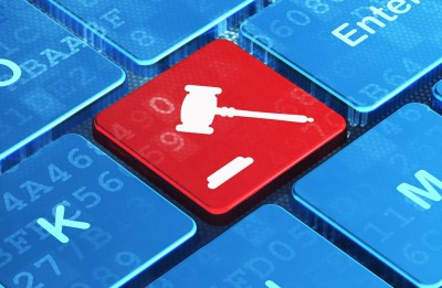 artificial intelligence in law represented by gavel on keyboard