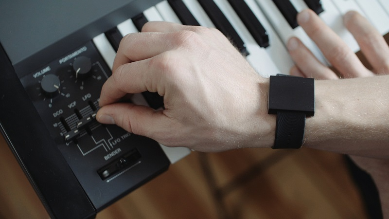 Basslet wearable tiny subwoofer on a musician's wrist