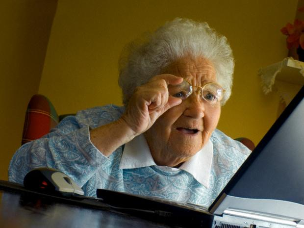 shopping for a laptop can make you feel like this old lady at her computer