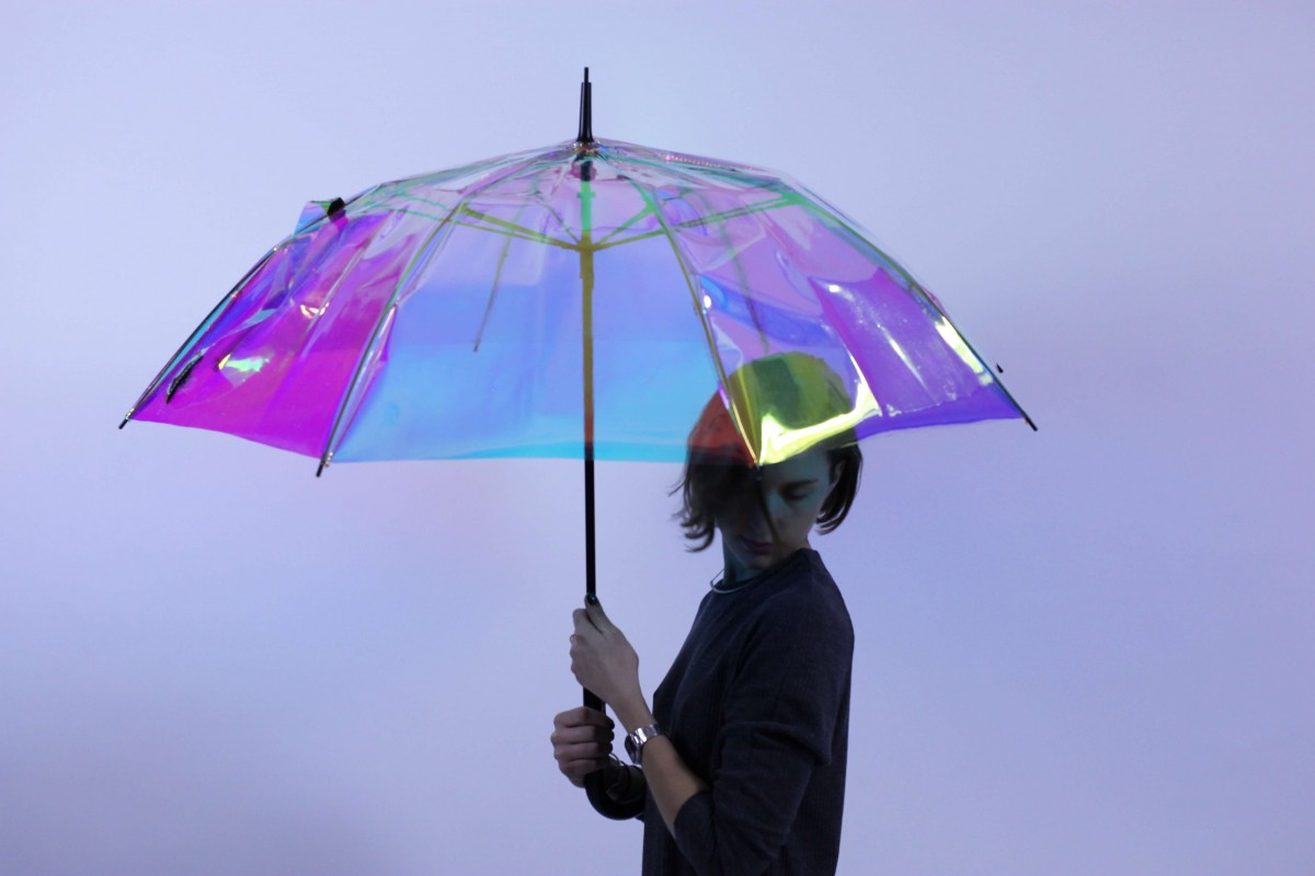 woman holding Oombrella smart umbrella