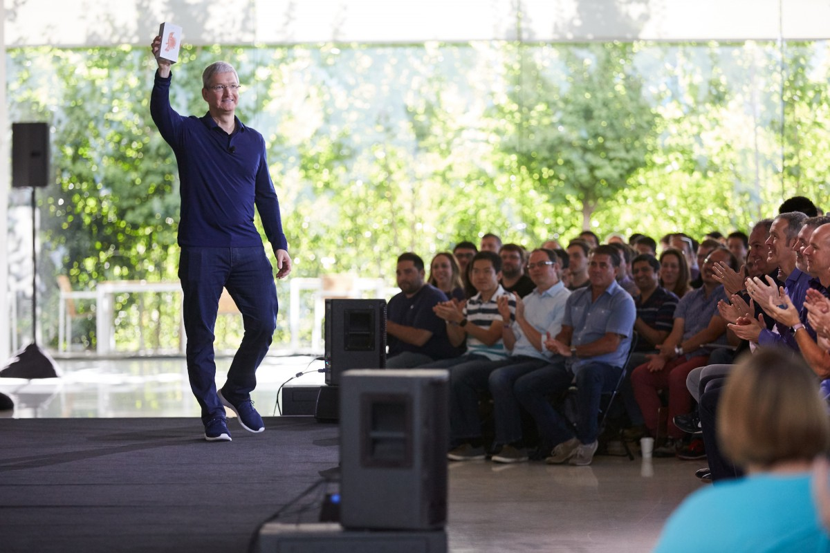 Tim Cook announcing iPhone sales