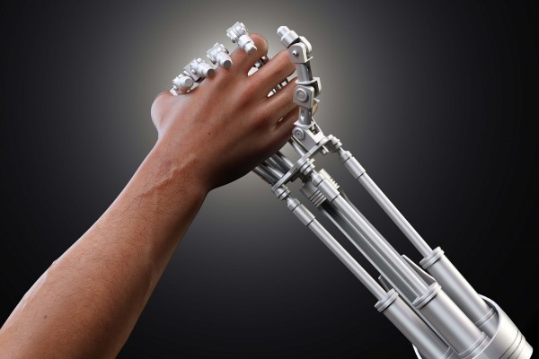 automation of workforce represented by human and robot hands
