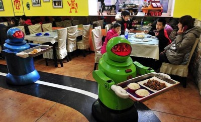 Robot servers bring food to Japanese clients.