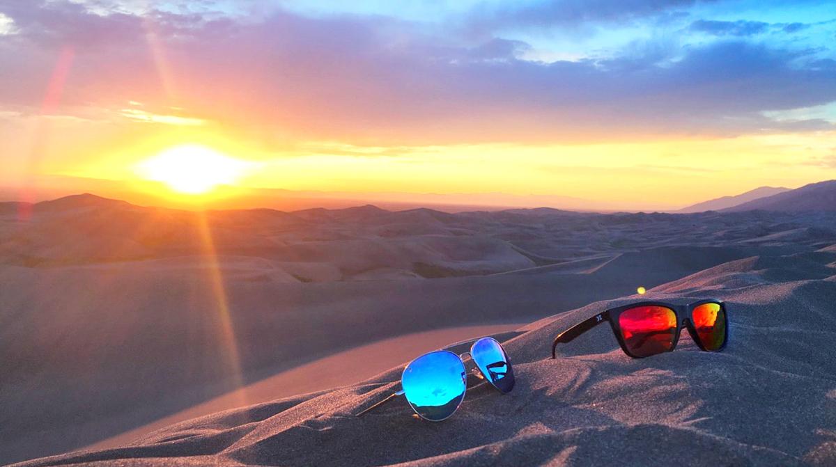 KZ sunglasses on the sand