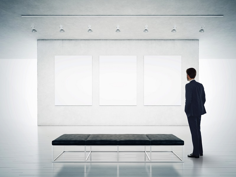 man staring at blank wall representing the feeling many website builders have