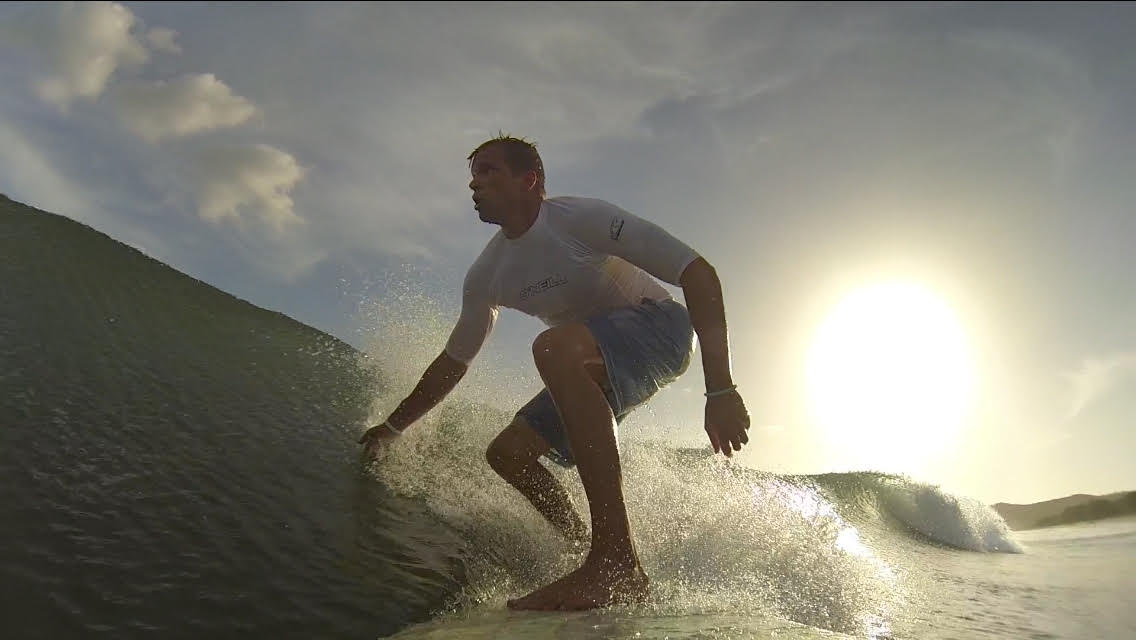 Sean Bingham, founder of KZ Gear and Adventure Hunt, surfing