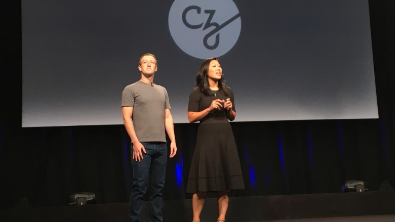 Mark Zuckerberg and Priscilla Chan on stage