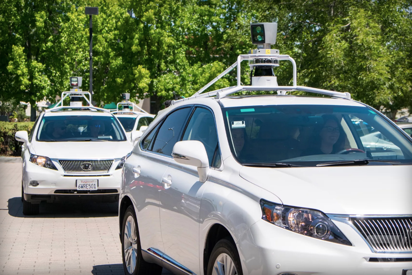 self-driving cars with humans taking a test drive