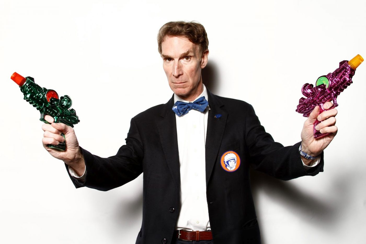 Bill Nye with water guns ready to explain exploding smartphones