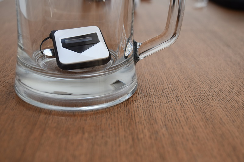 tiny personal breathalyzer in the bottom of a beer glass