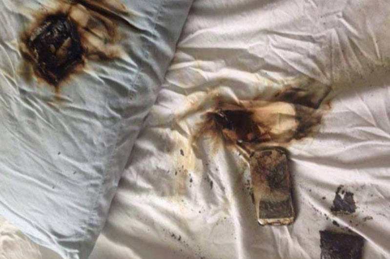 exploding smartphone left on a bed