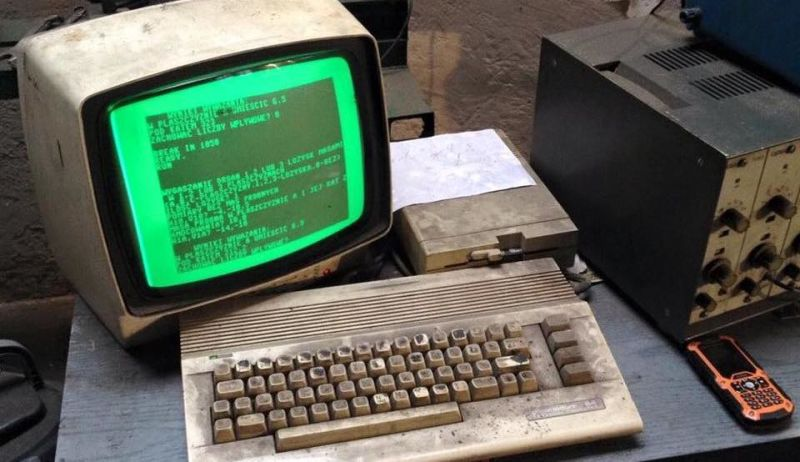 very dirty Commodore 64 in a an auto repair shop