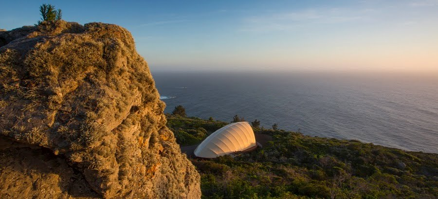 luxury tent on a cliff overlooking a beach