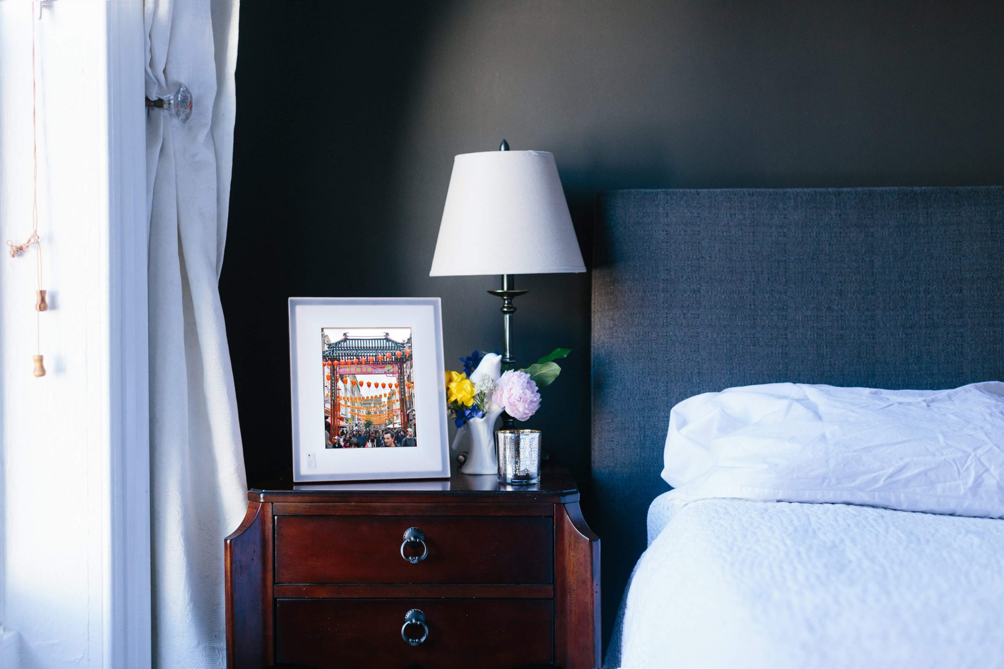 Aura digital photo frame sitting on a nightstand